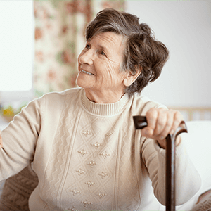 Smiling Elderly Woman with Cane