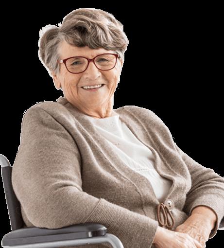Happy Senior Woman in Wheel Chair