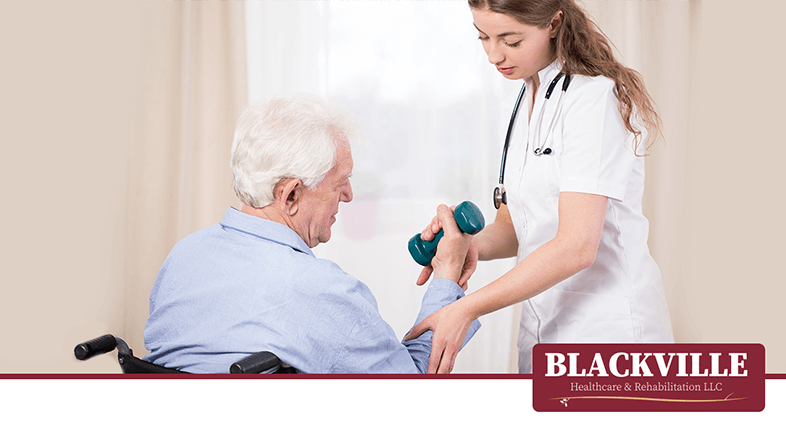 Nurse Works with Elderly Man on Weights as part of his physical therapy rehabilitationwith the Blackville Healthcare & Rehabilitation Logo