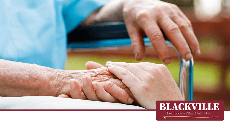 Young Hands Holding Elderly Hands with the Blackville Healthcare & Rehabilitation Logo